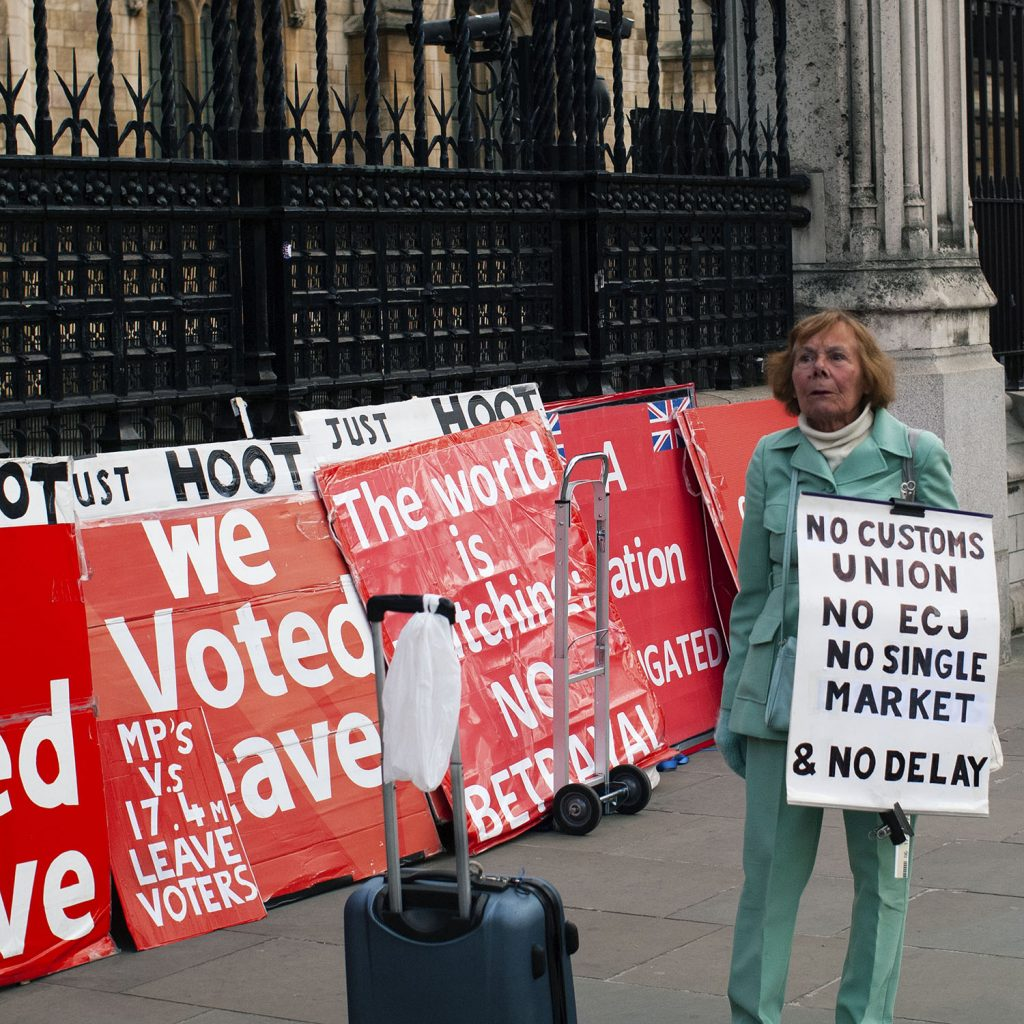 A woman protests against what she thinks is wrong with the European Union.
